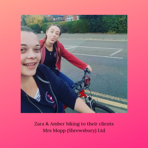 Mrs Mopp Shrewsbury team leader Zara, with domestic Moppette Amber, on their bikes riding to their clients. Both ladies are smiling